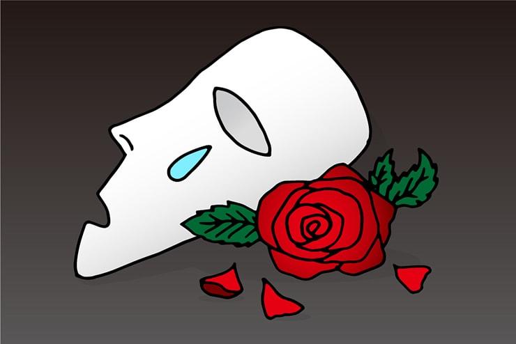 涙する仮面と真っ赤なバラ